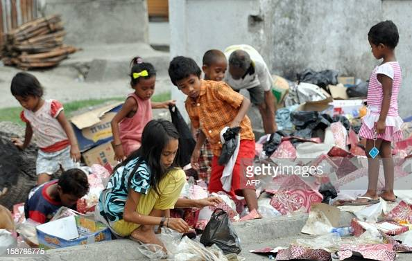 East Timorese children collect recycle items in Dili on December 28 2012 The UN winds up its peacekeeping mission on December 31 after 13 years in...