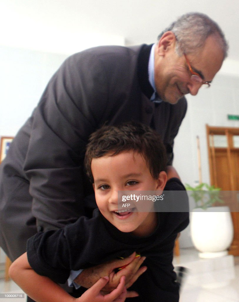 East Timorese President Jose Ramos-Horta holds Kay-Olo, the son of the Prime Minister Xanana Gusmao at the presidential palace in Dili onMay 20, 2010 during the independence day celebrations. The Nobel laureate Ramos-Horta said his young country had finally achieved peace and could look forward to prosperity as it celebrated eight years of independence from Indonesia. Ramos-Horta added the former Portuguese colony, which was annexed by Indonesia in 1975, had at last turned a page on its violent past.