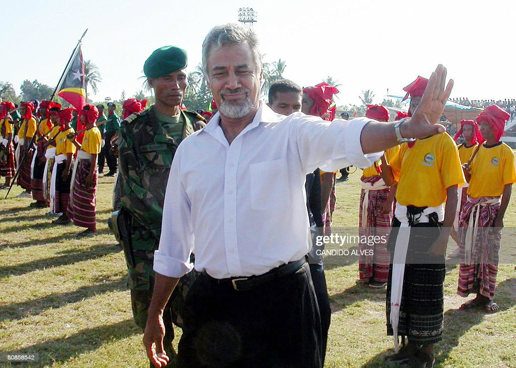 East Timorese President Xanana Gusmao (C) gestures during a ceremony marking the second anniversary of the youngest country in the world, in Dili 20 May 2004. East TImor celebrated the second anniversary of its independence with a display of pomp and pageantry overshadowed by abject poverty in one of the world's newest nations and a bruising oil dispute with Australia.