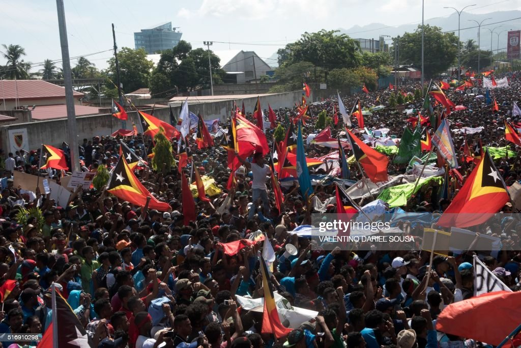 East Timorese protesters hold a rally over a maritime boundary between East Timor and Australia in Dili on March 22 2016 Protesters rallied on March...