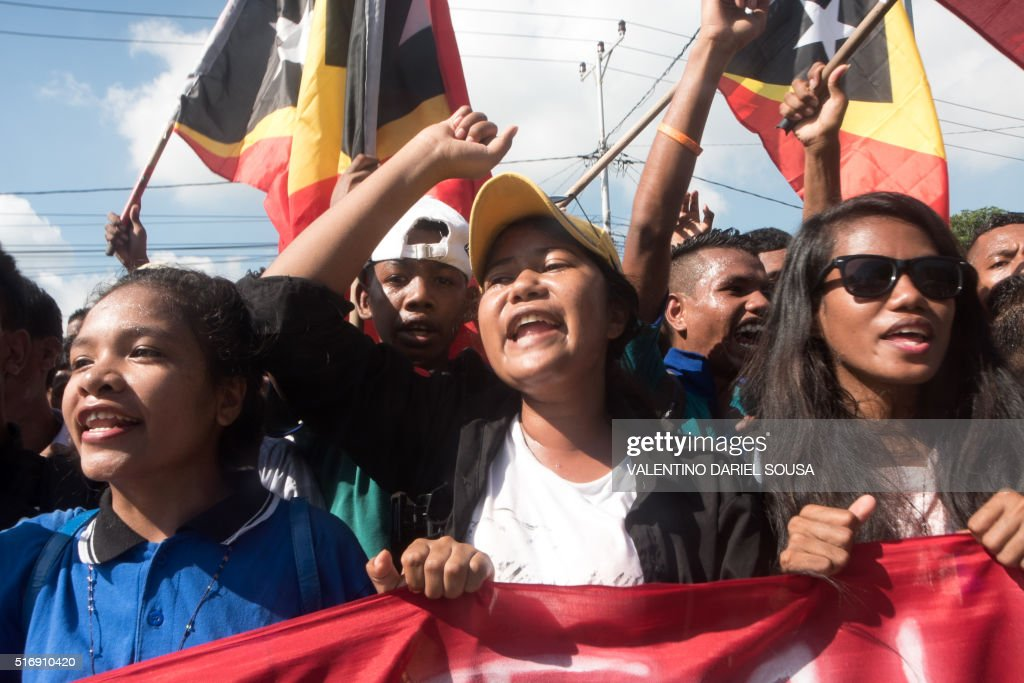 East Timorese students chant slogans during a rally over a maritime boundary between East Timor and Australia in Dili on March 22 2016 Protesters...