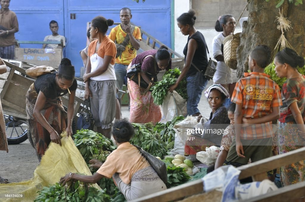 East Timorese vendors sell goods in the market in capital city of Dili on March 20 2013 East Timor is striking out on its own after 13 years of UN...