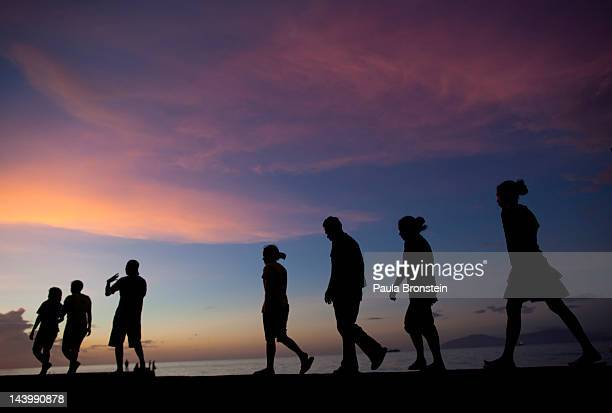 East Timorese walk along the beachfront at sunset April 20 2012 in Dili East Timor Millions have been spent on aid during the first 10 years as the...