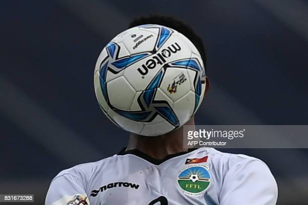 East Timor's Adelino Trindade Coelho Manek De Oliveira heads the ball against Vietnam during their men's football Group B round match at the 29th...