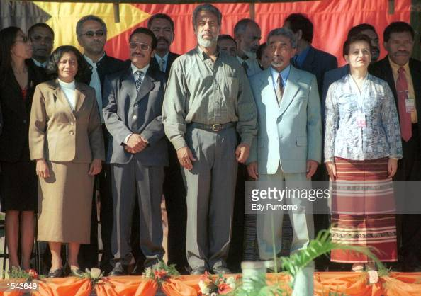 East Timor's President Xanana Gusmao poses with senior cabinet members after being sworn in front of the former UN headquarters May 20 2002 in Dili...