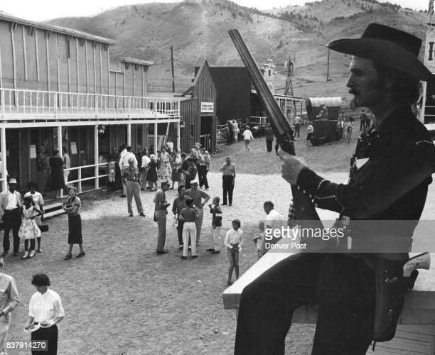 East Tincup 'Law' Keeps Eye On Crowd Marshal Billy Cantrell sixgun at side and shotgun in lap looks impressively impassive as he presides over...