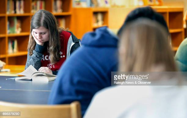 East Wake High School valedictorian Megan Faircloth left reads in the library on June 5 2017 at school in Wendell NC Faircloth recently spoke at a...
