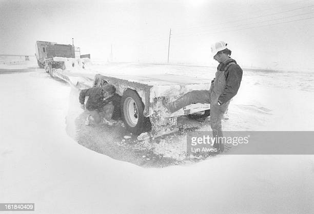 JAN 20 1988 170 eastbound closed at GunClub Road Steve Mitchell of Marysville Kansas had been parked on 170 long enough for a snow drift to form...