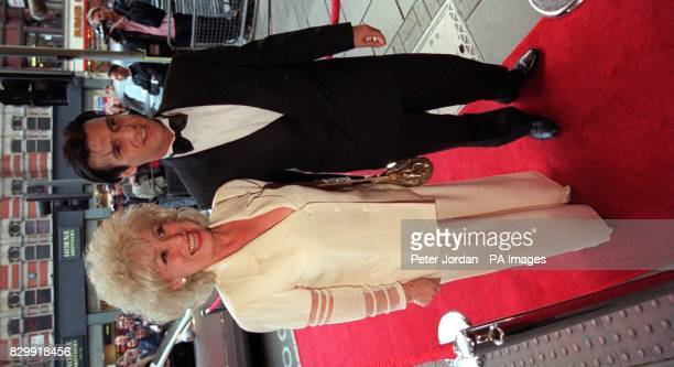 Eastenders actress Barbara Windsor and her boyfriend Scott arriving at London's Dominion Theatre this evening for the opening of the Disney musical...