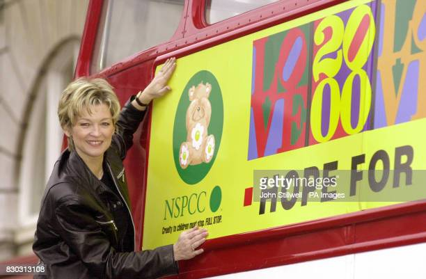 Eastenders actress Gillian Taylforth outside the London Transport Museum in London puts the finishing touch to a double deckerbus poster for the...