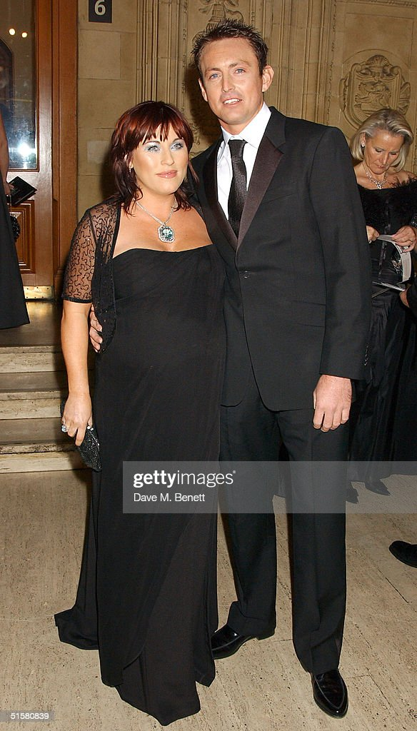'Eastenders' actress Jessie Wallace and partner Dave Morgan arrive at the '10th Anniversary National Television Awards' at the Royal Albert Hall on October 26, 2004 in London. The star-studded awards ceremony awards prizes as voted for by members of the public.