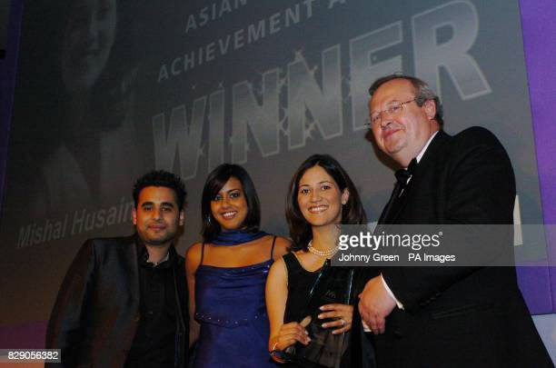 Eastenders stars Ameet Chana and Pooja Shah with Mishal Husain from London winer of the Young Achiever of the Year Award at the Asian Women of...