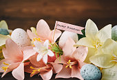 Easter background with lilies and Easter Blessings message