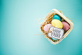 Easter background with pastel colored eggs