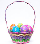 Enjoy Easter with this colorful basket of plastic decorative Easter eggs in green grass which are decorated with flowers, dots, swirls and stripes. Eggs come in blue, purple, pink, yellow and orange c