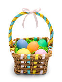 Easter Basket with Colored Eggs Isolated on White Background.