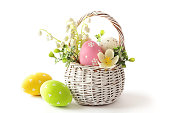 Colorful decorated easter eggs in basket. isolated on white background