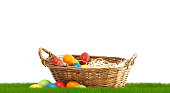 Easter basket with Easter eggs at 3d rendering green grass meadow
