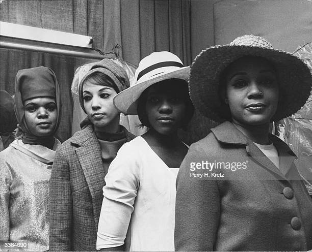 Easter bonnets on parade at a fashion show sponsored by large textile and fashion stores in Harlem New York