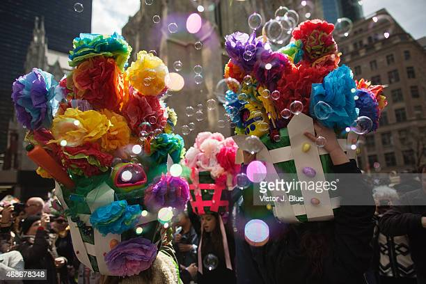 Easter bonnets spouting bubbles make their way along Fifth Avenue during the annual Easter Parade April 5 2015 in New York City The parade attracts...