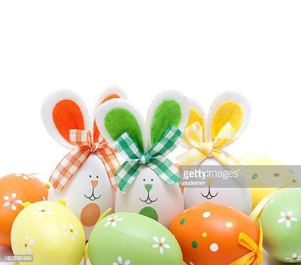 Easter bunnies and eggs isolated on white background