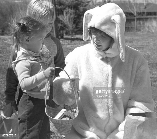 Easter Bunny Cathy DeGiovanni 19 a volunteer from the Kappa Theta Sor at CU boulder gave kids an extra goodie after the hunt at North Lake Wood...