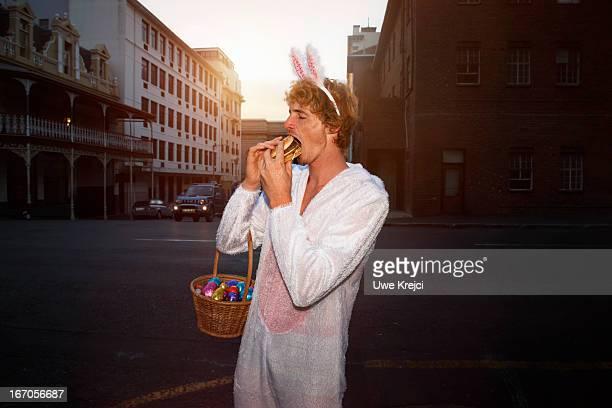 Easter Bunny eating burger