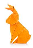 Easter bunny of orange origami. Isolated on white background