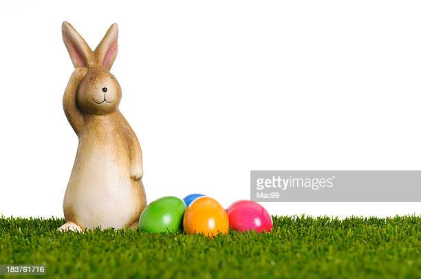 Easter bunny with heap of eggs