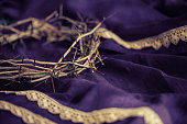 Easter Crown of Thorns on a Purple Robe with Dramatic Lighting