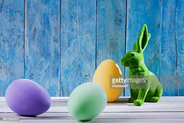 Easter decoration with green Easter bunny and three eggs