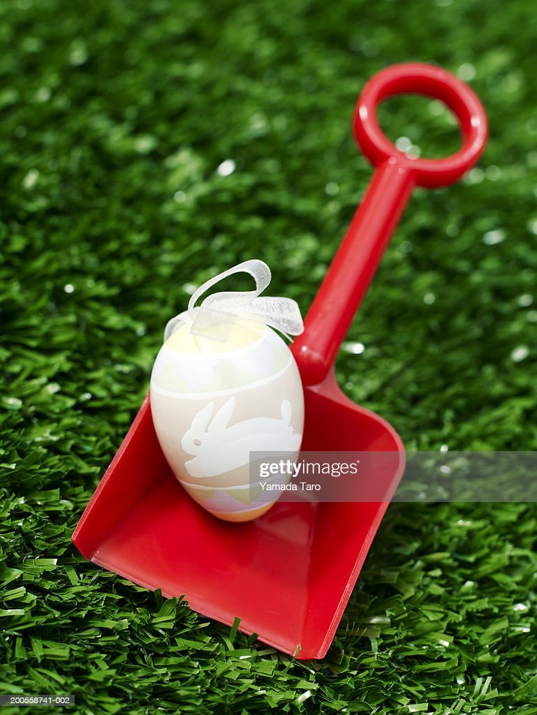 Easter egg on toy shovel : Stock Photo
