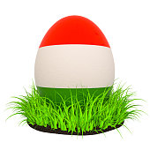 Easter egg with flag of Hungary in the green grass, 3D rendering isolated on white background