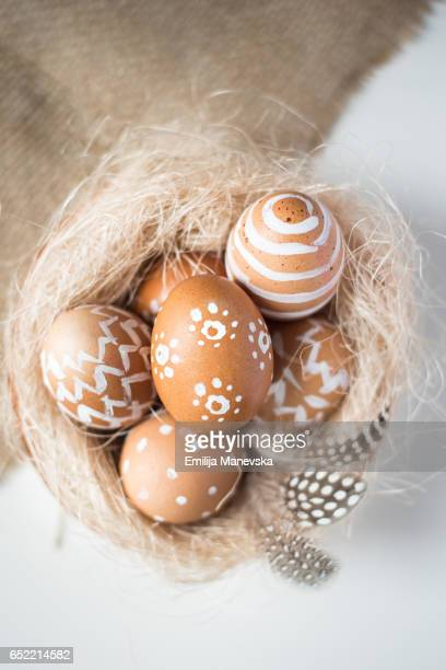 Easter eggs decorated with different white shapes