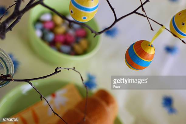 Easter eggs hanging on twigs