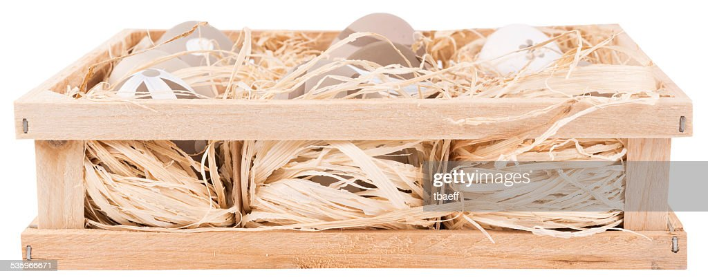 Easter eggs in a wooden crate. isolated on white background. : Stock Photo