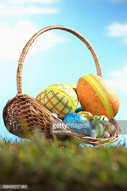Easter eggs in basket on grass, ground view