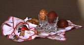 colored an onions peel of egg in crystal glasses by a light holiday of Easter on the embroidered white napkin
