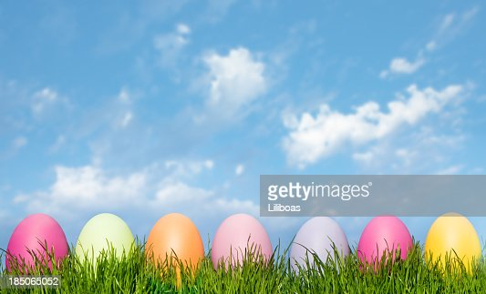 Easter Eggs In Green Grass on a Blue Sky