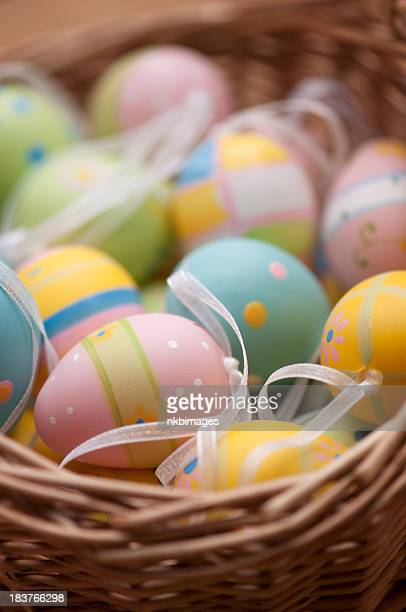 Easter eggs in wooden egg basket