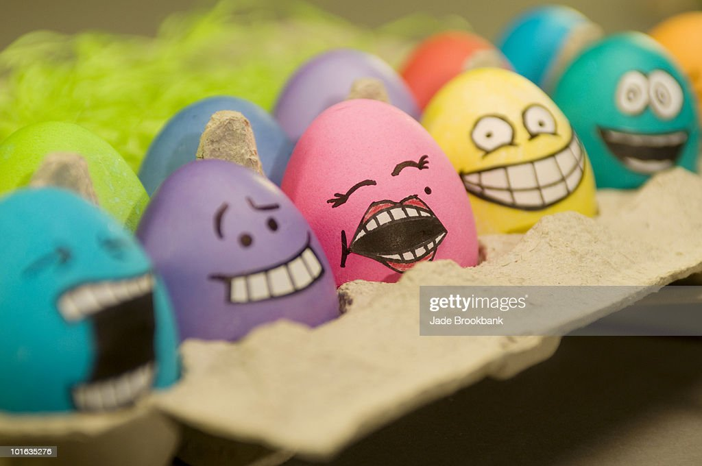 Easter eggs with faces : Stock Photo