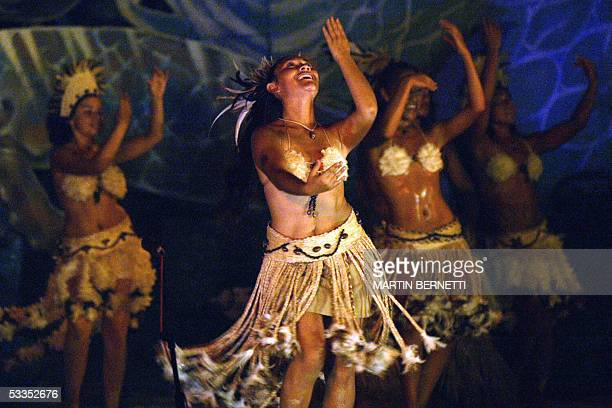 TO GO WITH STORY CHILITOURISMEECONOMIE BY PAR GILLES BERTIN A file photo taken 12 February 2005 on the Easter Island Chile shows dancers performing...