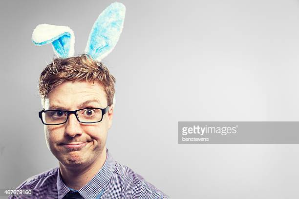 Easter nerd with blue rabbit ears looking confused