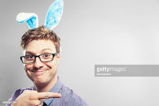 Easter nerd with rabbit ears in a photography studio