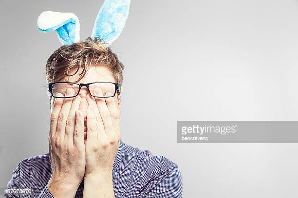 Easter nerd with rabbit ears looking stressed and worn out.