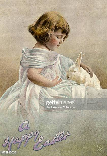 Easter postcard featuring photograph of young girl petting white rabbit