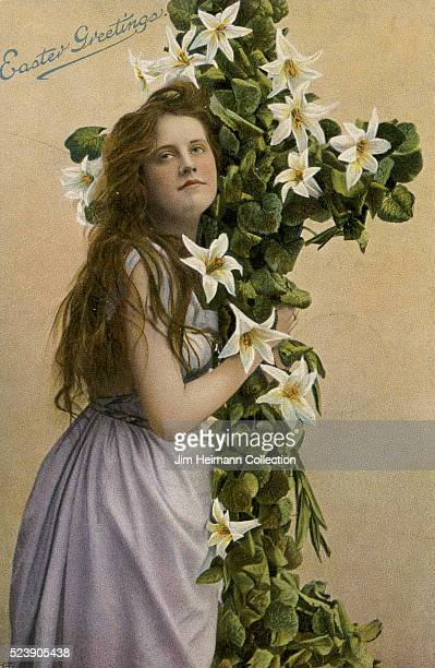 Easter postcard featuring young woman holding crucifix covered with lilies