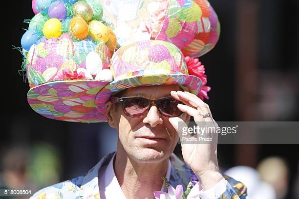 Easter Sunday was marked by the annual Bonnet Parade in Midtown filling 5th Avenue with hundreds of colorful hats costumes decorating adults kids pets