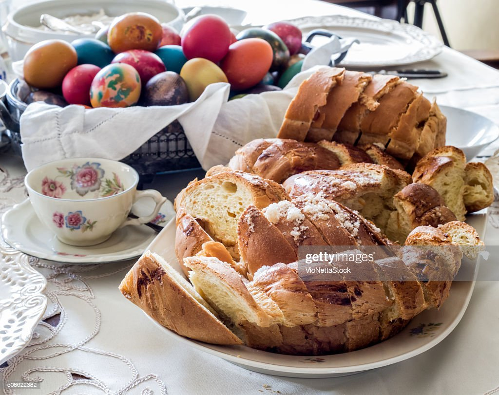 Easter table arrangement with bread, eggs and hot drink : Stock Photo