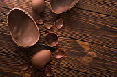 easter tasty chocolate egg on a wooden table. holiday candy dessert. top view
